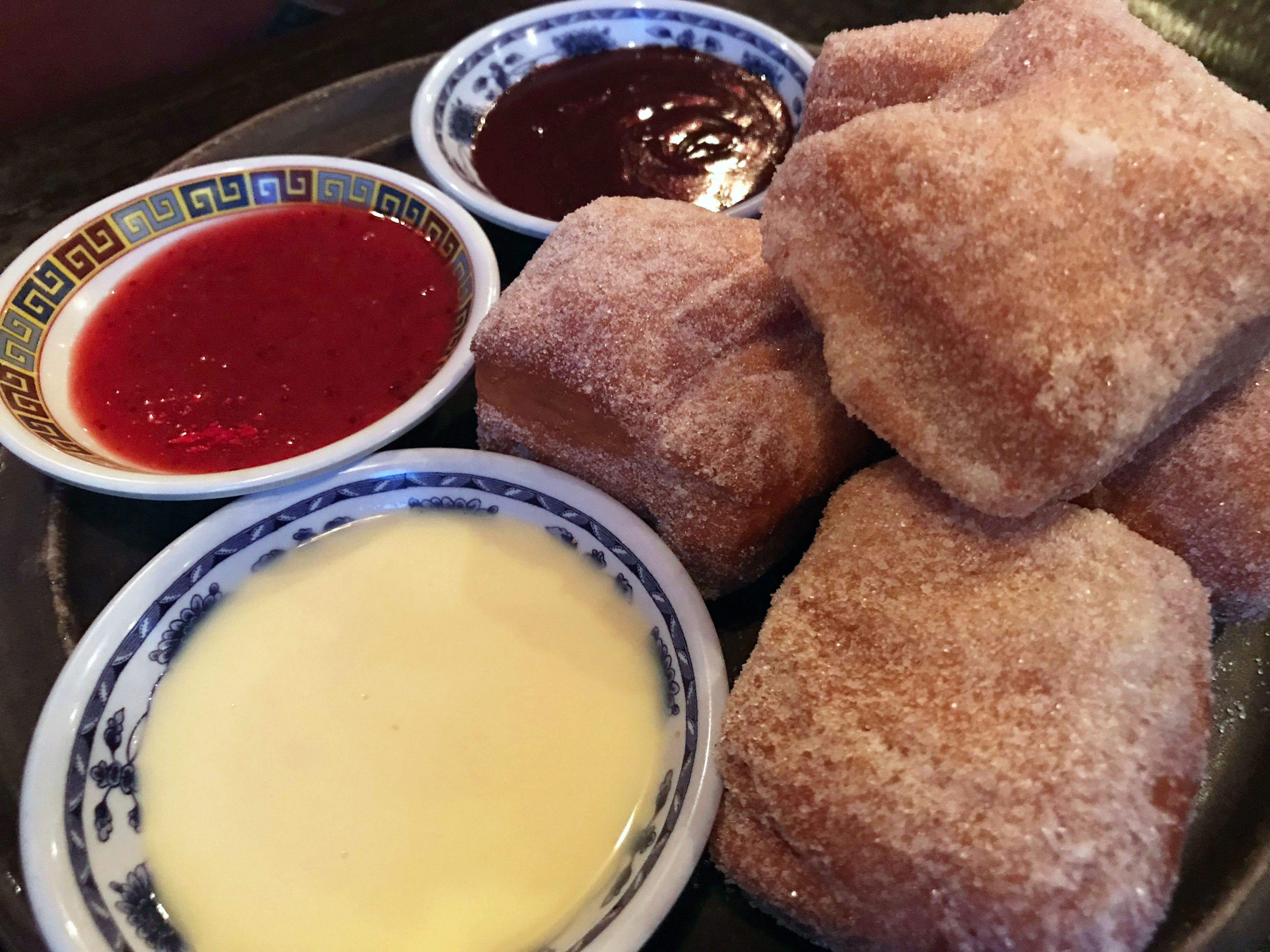 Freshly made Chinese takeout doughnuts are a staple at Dandan, the modern American Chinese restaurant at 360 E. Erie St. They're served with orange ganache, strawberry jam and cinnamon anglaise for dipping.