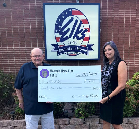 The Mountain Home Elks Lodge recently donated $500 to Court Appointed Special Advocate of North Arkansas (CASA). Pictured are: Stu Friend (left) Elks president and Tracie Pape, CASA executive director. CASA provides community trained volunteers, who become heroes in the lives of abused and neglected children, by giving hope and a voice to these children, who otherwise stand alone while in the foster care system. For more information on becoming a CASA advocate, call Pape at (281) 923-1952 or go to www.casaofna.org.