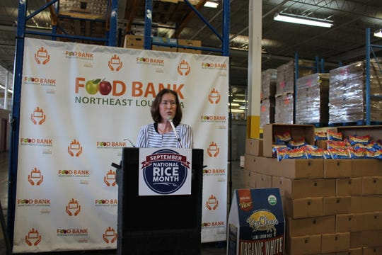 Jean Toth, executive director of the Food Bank of Northeast Louisiana, speaks at a Thursday event at the Food Bank of Northeast Louisiana. The Food Bank accepted a rice donation from KenChaux rice in honor of Hunger Action Month and National Rice Month.