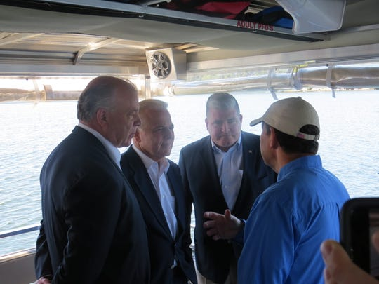 From left, New Jersey Senate President Stephen Sweeney, with senators Joseph  Pennacchio and Oroho aboard the Lake Hopatcong Foundation's Floating Classroom, speaking to foundation president Marty Kane about algae blooms that prevented swimming there for most of the summer. Sept. 19, 2019.