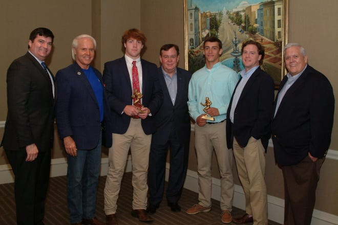 Mays McMillan from Trinity Presbyterian School and Levi Arrington from Billinglsey High School were honored as players of the week at the Montgomery Quarterback Club, Sept. 17. Tony Barnhart, SEC Network college football analyst, was the featured speaker.  From left, Quarterback Club board members Ben Venable and Perry Hooper, Jr., Mays McMillan, Tony Barnhart, Levi Arrington, Board members Kendall Leverette and Dr. David Bowen.