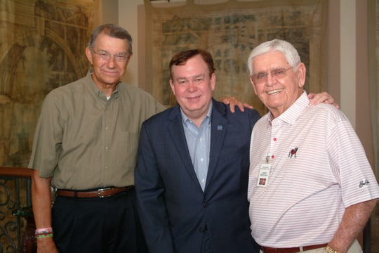 University of Georgia graduates Steve Schwartz and Larry Brittain greet fellow UGA alumnus, Tony Barnhart, prior to Barnhart's talk to the Montgomery Quarterback Club, Sept. 17