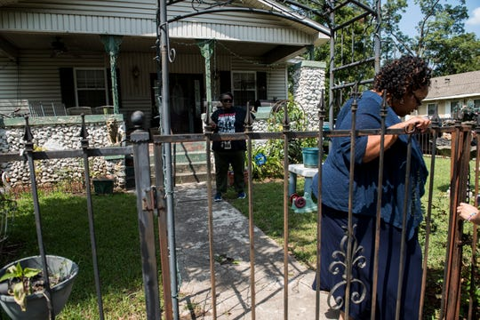 Valencia King arrives at her mother's home in the Woodlawn neighborhood of Birmingham, Ala., on Thursday, Sept. 12, 2019.