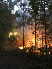 An Alabama Forestry Commission bulldozer puts in a fire break around the Alpine fire which burned 500 acres.