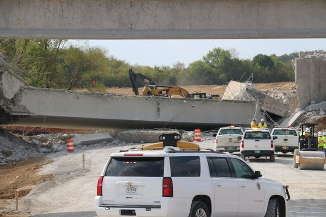 A piece of construction equipment fell during the planned demolition of a Saturn Parkway bridge extension on Wednesday.