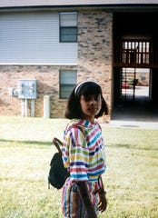 Rupali Patel, around 8 years old, outside her family's first apartment in Clarksville, Tenn. This was about the time when Patel started using fashion to try to get validation from her classmates.