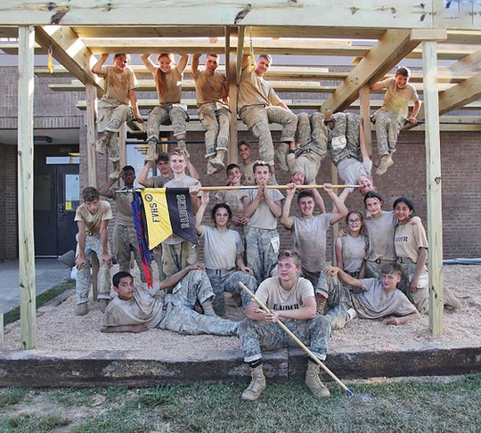"""The Fairview High JROTC Raiders celebrate the completion of Bring the Sting on Sept. 14, 2019, and show off their new """"jungle gym,"""" recently constructed by the FHS woodshop."""