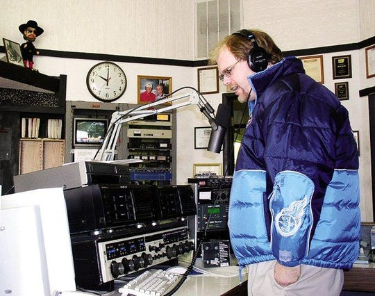 "In this 2002 photo, Crazy"" Chuck Dauphin, programming director at WDKN, introduces a country song on the air. Herald file photo"