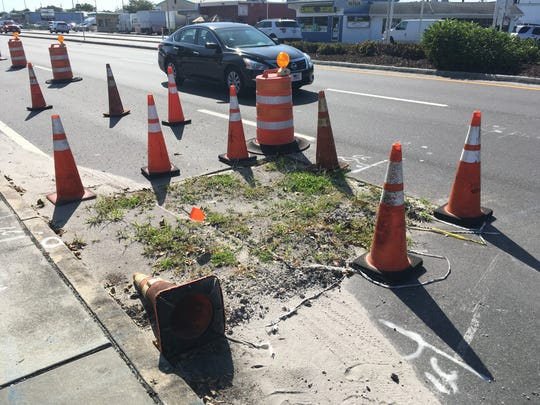 This patch of Davis Boulevard, complete with weeds, has been leading to lane closures since June and backups during heavy traffic periods.