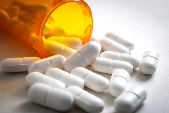 Bottle of prescription drugs and hydrocodone pills.