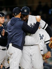 Sep 18, 2019; Bronx, NY, USA; New York Yankees starting pitcher CC Sabathia (52) and manager Aaron Boone (17) hug after Sabathia was taken out of the game against the Los Angeles Angels during the third inning at Yankee Stadium. Mandatory Credit: Andy Marlin-USA TODAY Sports