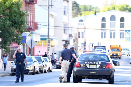 Law enforcement at the scene of a pedestrian hit by a bus on Main Street near Mary Street in Paterson on Thursday, September 19, 2019.