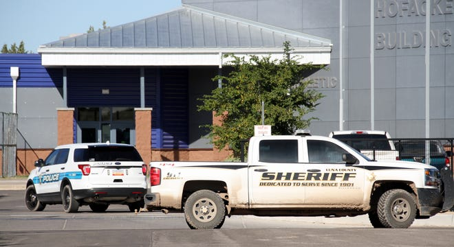 Police and sheriff's units were stationed at the Deming High School parking lot.
