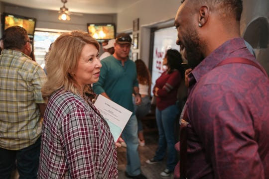 Teresa Tapia and Austin Trout speak after an announcement of a local fight card at The Game Sports Bar and Grill in Las Cruces on Thursday, Sept 19, 2019.