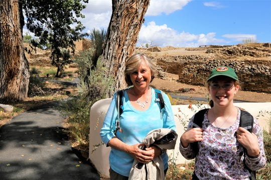 Archaeologist Victoria Atkins, left, and intern Moriah Sonnenberg are part of the team assisting historian Fred Blackburn in his survey of historic inscriptions at Aztec Ruins National Monument.