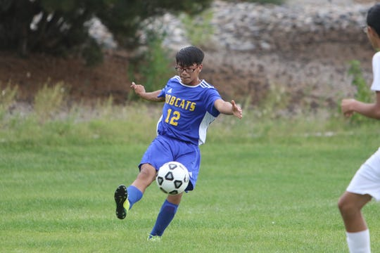 Bloomfield's Chris Jimenez keeps the ball in play against Grants during a boys soccer match on Tuesday, Sept. 10 at Mesa Alta Soccer Field in Bloomfield.