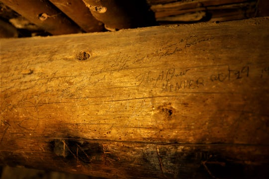 A lengthy inscription by a Phila Bliven covers the viga on the left side of this image capture in a room in the West Ruin at Aztec Ruins National Monument. Her signature is visible at the top right of the viga.