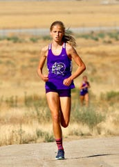 Sophia Biesinger of Shadow Hills is ahead of the pack during a recent cross country meet.