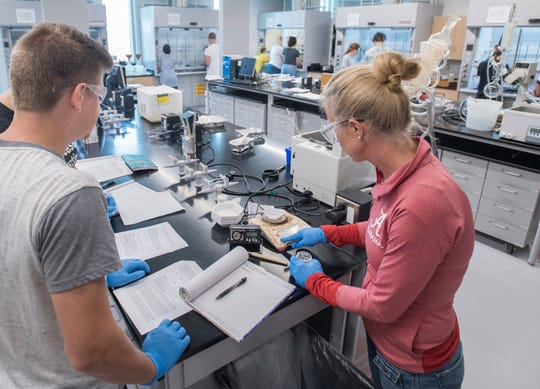 Ben Lassiter, left, and Sandra Snow work in the organic chemistry lab at the Hal Marcus College of Science and Engineering's new Laboratory Sciences Annex at the University of West Florida in Pensacola on Thursday, September 19, 2019.