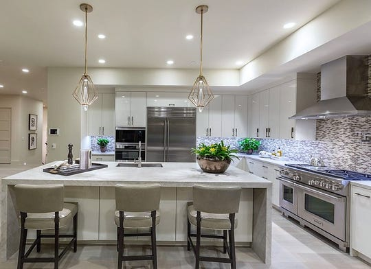 Paul and Shari purchased this contemporary-style home with modern appliances including a Sub Zero refrigerator and a Zephyr hood.