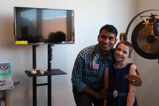 Peyton Gonzales with her doctor, Dr. Naresh Reddivalla.