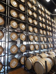 Barrels of aging spirits at SanTan Brewing's production facility in Chandler.