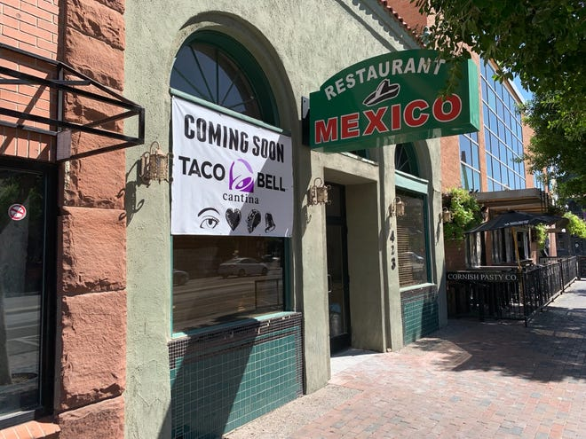A sign advertising a new location of Taco Bell Cantina posted at 423 S Mill Avenue in Tempe on Thursday, Sept. 19.