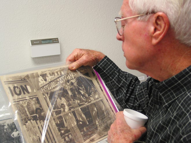 Bill Hogan, 77, tries to identify childhood friends in the historic photos on display at the John C. Lincoln Health Network 75th Anniversary Party. Hogan's family moved from Kansas City, Missouri, to the desert in 1928 because his father had tuberculosis.