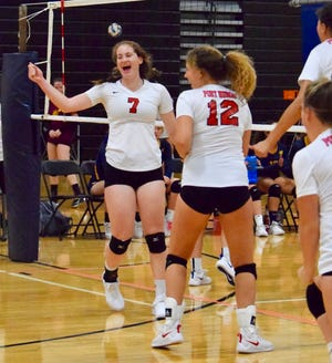 Port Huron junior Emma Trombly celebrates a point during a volleyball match earlier this fall.