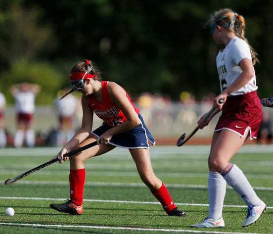 Roy C. Ketcham's Megan McConologue pulls away from Arlington's Sabrina Horan during Wednesday's game on September 18, 2019.
