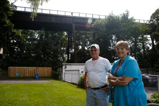 George and Stephanie Shaw in their back yard which is directly under the Walkway Over the Hudson in the City of Poughkeepsie on September 16, 2019.
