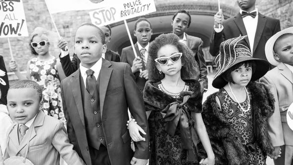Costumed children and adults gather May 14, 2019 for a reenactment of the Selma to Montgomery March civil rights protest at the pedestrian bridge at Marist College. A project of the Legacy Makers: Past, Present & Future, the photo session includes children ages 5-16 years, directed by Ondie James.