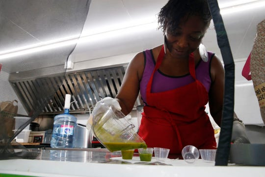 Marvalous James prepares an energy shot in her food cart, JustAtaste, which is located on the Poughkeepsie approach to the Walkway Over the Hudson on September 16, 2019.