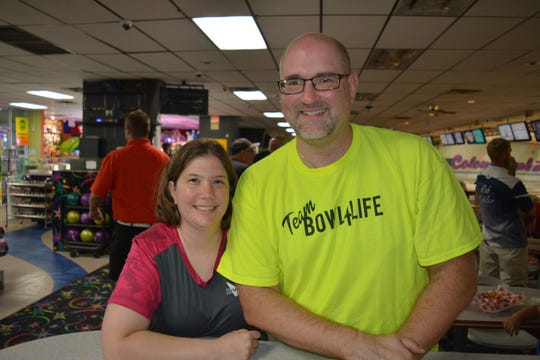 The husband-and-wife team of Jen and Travis Sparks recently won a state mixed-doubles title together.