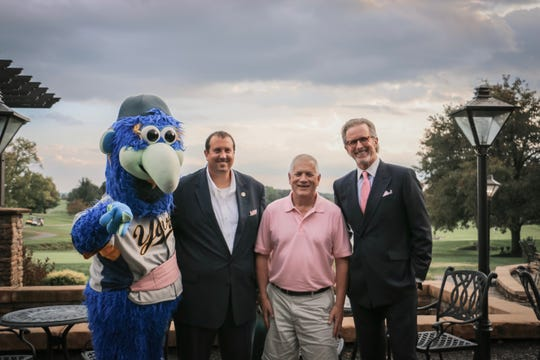From left to right, Downtown from the York Revolution, State Rep. Seth Grove, Dave Russell and Arthur Seifert pose for a photo.