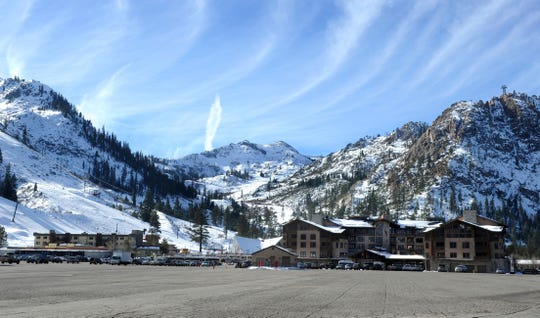 This 2011 file photo shows the base village at Squaw Valley in Olympic Valley, Calif. A wilderness protection group has filed a lawsuit to try to block construction of a 2.2-mile long gondola that would pass through a national forest to connect Squaw Valley to a neighboring Lake Tahoe ski resort. The conservationists want a California judge to set aside Placer County's approval of the project they say would destroy critical habitat for a rare, federally protected frog and lead to irreversible loss of natural landscape on the edge of a high Sierra wilderness area.