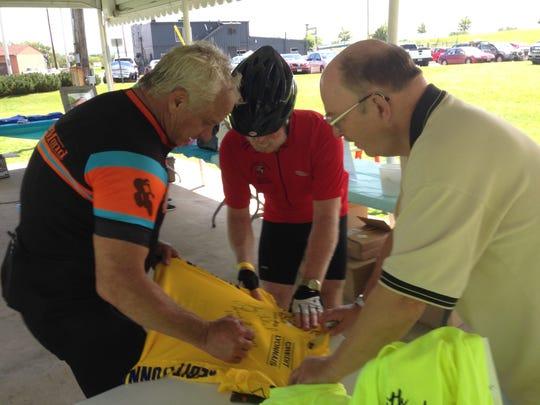 Greg LeMond, left, is
