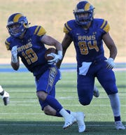 Angelo State University quarterback Payne Sullins picks up some yardage as tight end Cason Brown gets ready to block during the season opener against Western Oregon at LeGrand Stadium at 1st Community Credit Union Field Thursday, Sept. 5, 2019.
