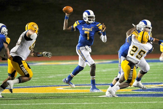 Angelo State quarterback Kyle Washington throws a pass against Texas A&M-Commerce during a 2014 game. Washington led the Rams to a 9-3 record that season, which included their first NCAA Division II playoff win since 1997.