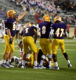 Byrd's Carson Bruno (94) signals for a first down during a game last season. The junior recently committed to Louisiana Tech.