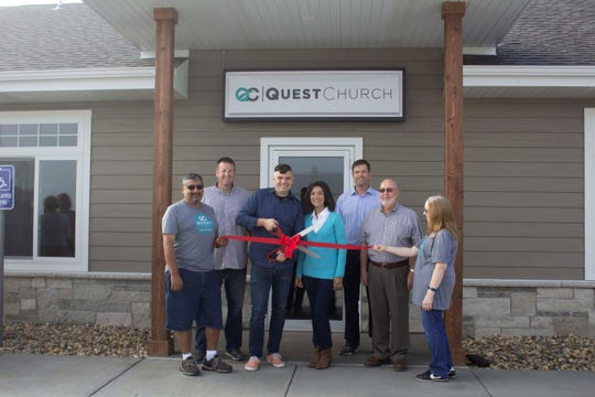 The Dell Rapids Chamber of Commerce ribbon cutting at Quest Church includes (left-to-right): Ricco Regino, Pat Fritz (Fit Lawn Landscaping), Pastors Brandon and Marlana Wenzel, Dan Ahlers from the Dells Chamber of Commerce President, Mayor Tom Earley and Marla Regino.