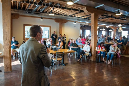 Startup Sioux Falls founder Matt Paulson speaks to crowd of local entrepreneurs gathered at Queen City Bakery for the first ever Startup Social.