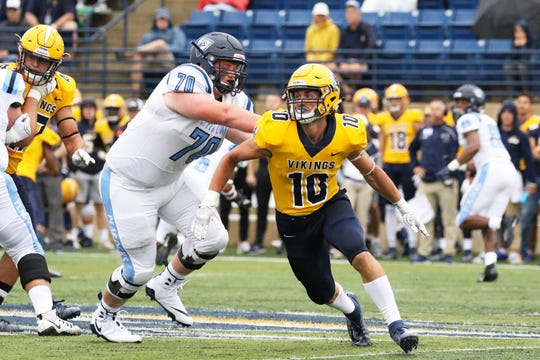 Luke Fritsch (10) and Augustana won their home opener 52-0 over Upper Iowa