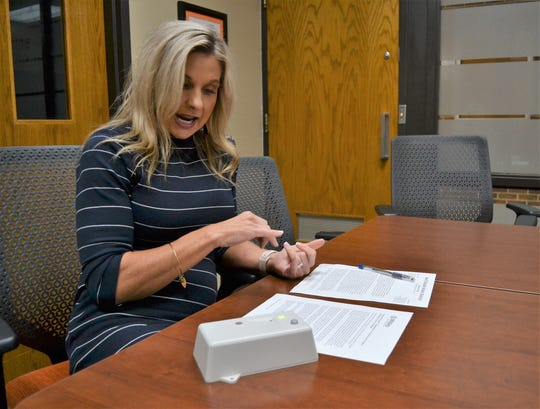 Dell Rapids Superintendent Summer Schultz discusses the purpose of installing vape sensors, like the one on the table in front of her, in bathrooms and around her high school and middle school campuses during the first couple weeks in September to reduce vaping among teens. Her district is one of several in southeastern South Dakota attempting to be proactive in curbing the use of vaping products by teens at school.