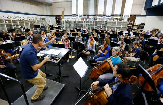 Kyle Wiley Pickett leads the Springfield Symphony Orchestra during a rehearsal at Central High School on Tuesday, Sept. 17, 2019.