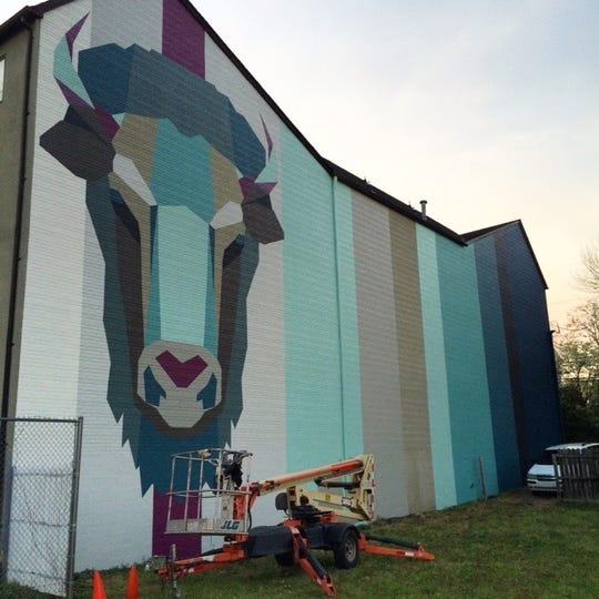 "Christy Baker has a large portfolio of mural work, including this ""GeoBuffalo (Bison)"" in Charlottesville."