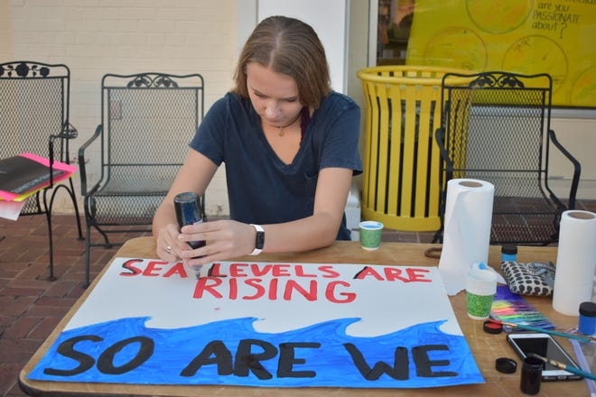 Activists painted posters on Sept. 18 at The Spencer Center for Civic and Global Engagement in preparation for Friday's climate strike.