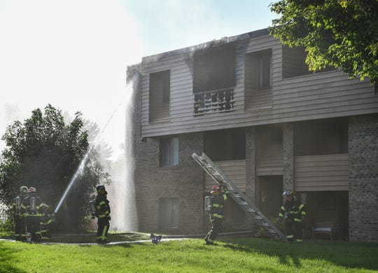 St. Cloud firefighters respond to an apartment fire on 15th Street North Thursday, Sept. 19, 2019, in St. Cloud.