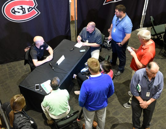 St. Cloud State head coach Brett Larson has a crowd of reporters to speak to at NCHC Media Day Thursday, Sept. 19, 2019, at Xcel Energy Center.