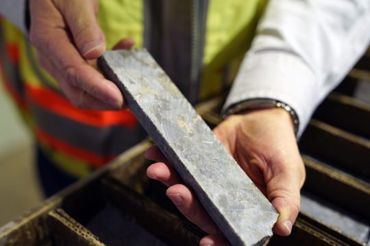 In this May 29, 2019, file photo, core samples show the mineral deposits sought after by miners at the site of the Polymet copper-nickel mine in Hoyt Lakes, Minn. The Minnesota Court of Appeals has put two key permits for the planned PolyMet copper-nickel mine on hold ahead of a hearing next month. The appeals court says the Department of Natural Resources failed to adequately consider two important developments that happened after the agency issued the permits. (Anthony Souffle/Star Tribune via AP, File)
